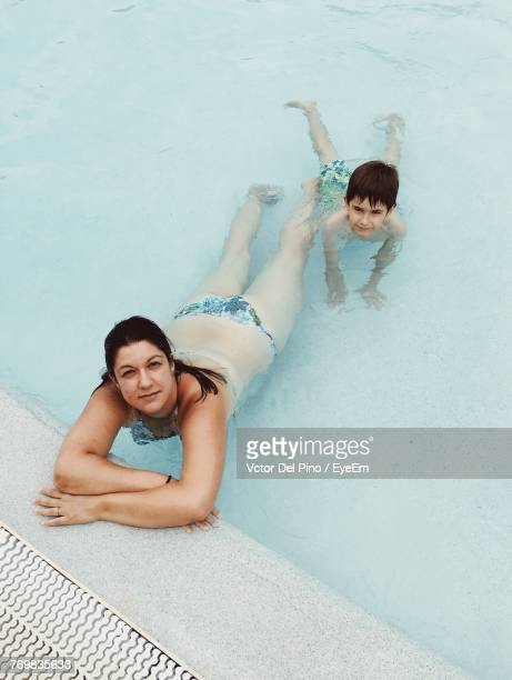 Portrait Of Woman With Son In Swimming Pool