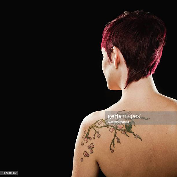 Portrait of Woman With Tattoo on Back