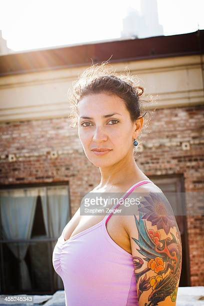 portrait of woman with tattoos