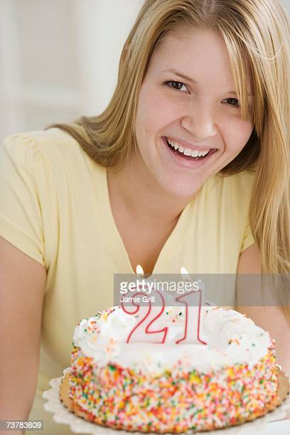 Portrait of woman with Twenty First birthday cake