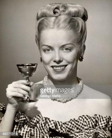Portrait of woman with upraised glass : Stock Photo