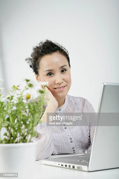 Portrait of woman working at computer