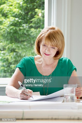 Portrait of woman writing : Stock Photo