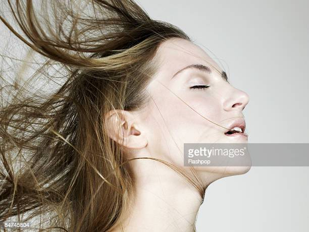Portrait of woman's hair blowing in the wind