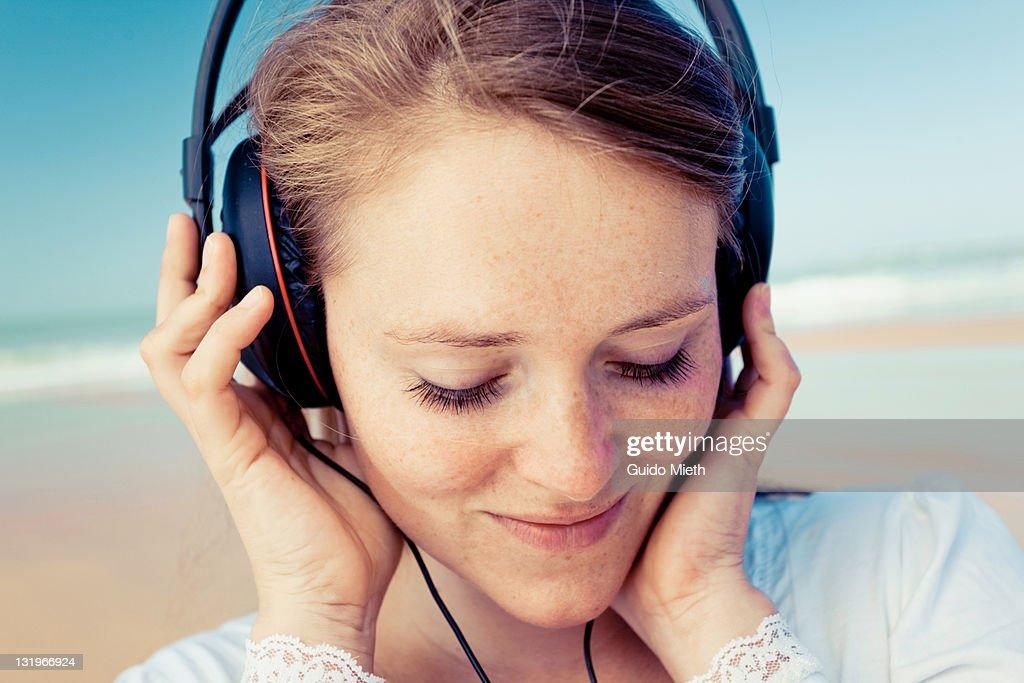 Portrait of women listen to music on beach. : Stock Photo