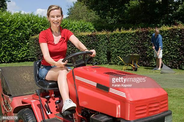Portrait of women on lawnmower