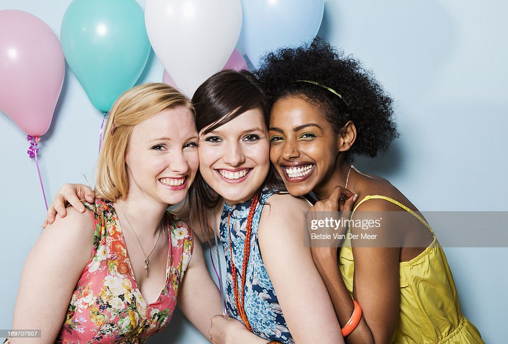 portrait of women together holding balloons : Stock Photo