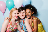 portrait of women together holding balloons