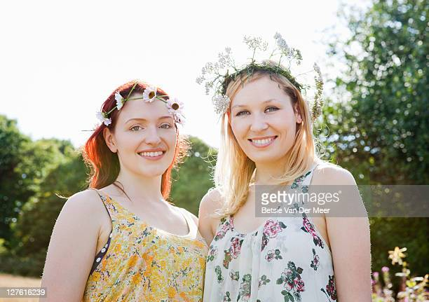 portrait of women wearing daisy chains.