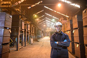 Portrait of worker in protective clothing in steel foundry