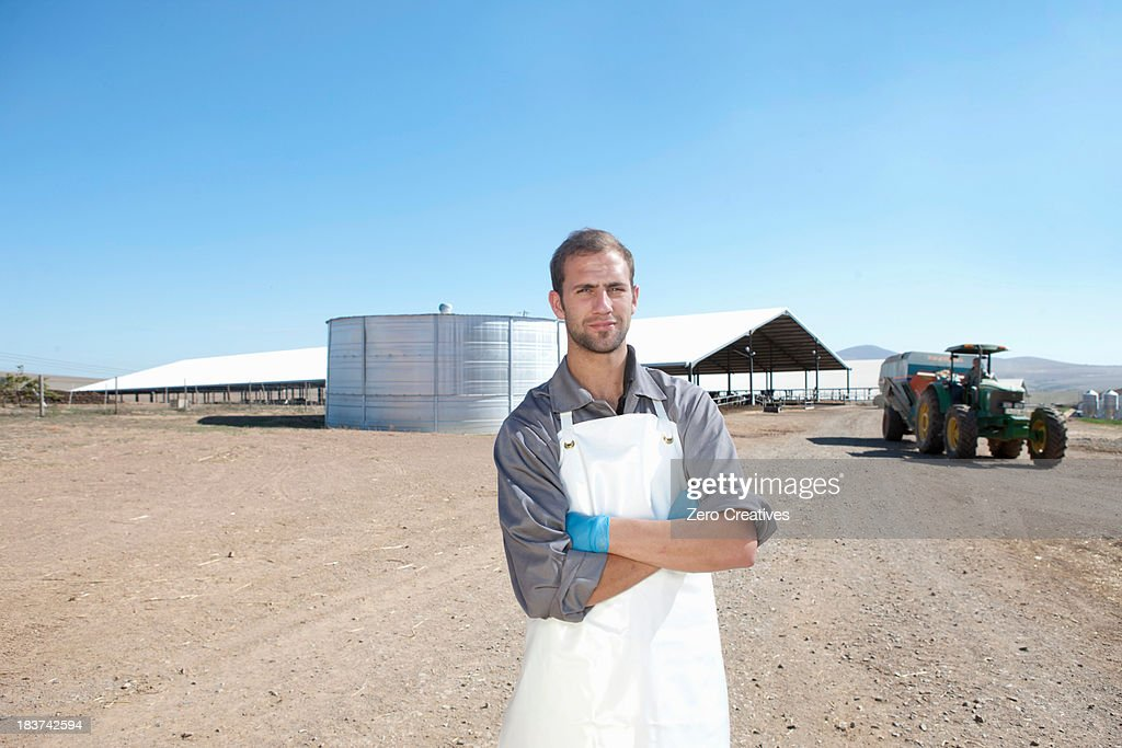 Portrait of worker on dairy farm