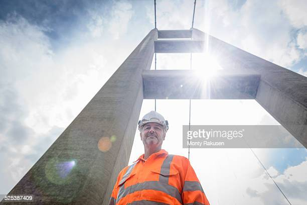 Portrait of worker on suspension bridge. The Humber Bridge, UK was built in 1981 and at the time was the worlds largest single-span suspension bridge