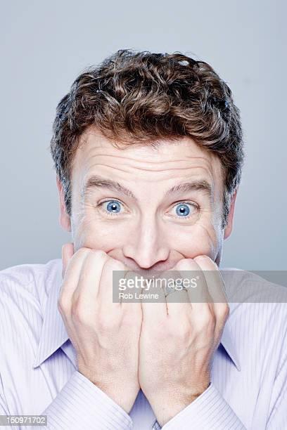 Portrait of worried mid adult man, studio shot