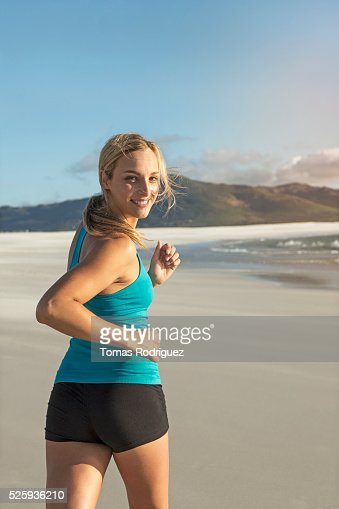 Portrait of, young adult woman jogging : Stock Photo