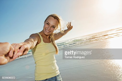Portrait of young adult woman standing on beach : Stockfoto