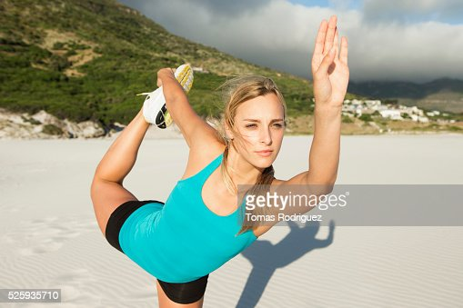 Portrait, of, young adult woman, stretching : Foto stock