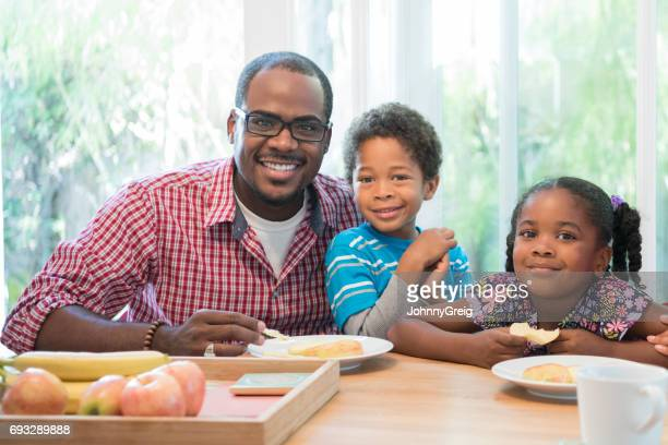 Portrait of young African American man with his two children