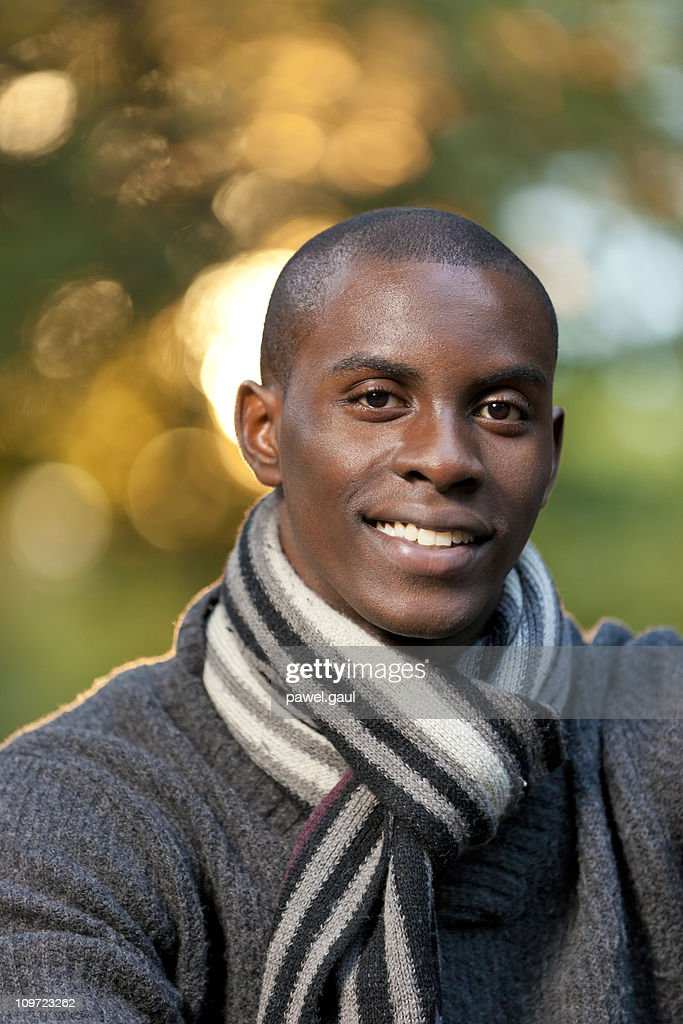 Portrait of young Afro-American man outdoors : Stock Photo