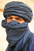Portrait of young Algerian man in turban