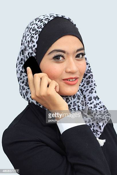 Portrait of young and successful businesswoman using mobile phone