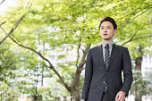 portrait of young asian businessman in park