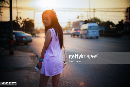 Portrait of young asian woman standing side of street : Stock-Foto
