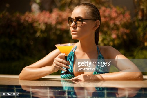 Portrait of young attractive woman having good time in swimming : Stock Photo