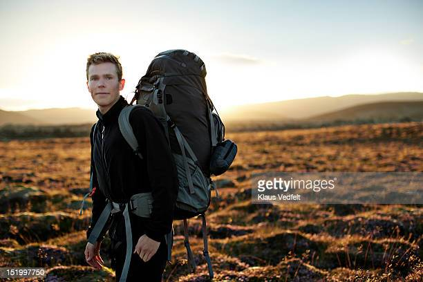 Portrait of young backpacker smiling