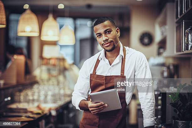 Portrait of Young barista in cafe shop