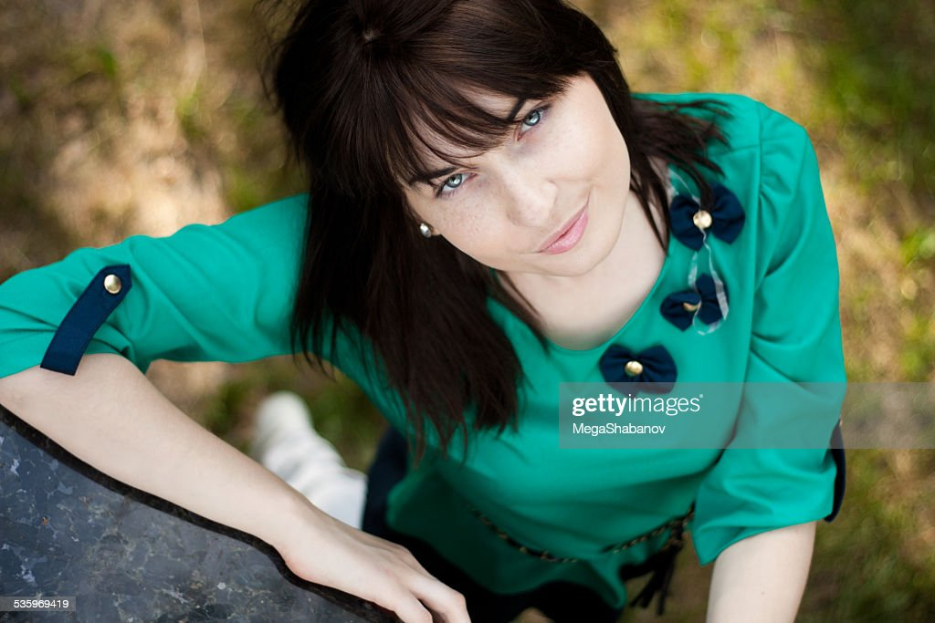 Portrait of young beautiful long-haired woman : Stock Photo