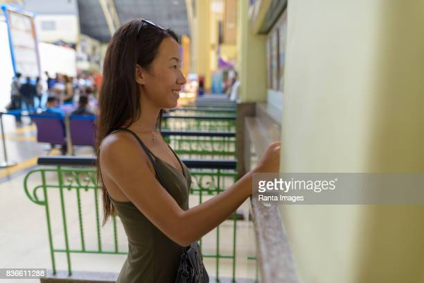 Portrait of young beautiful multi-ethnic tourist woman at the railway station Hua Lamphong in Bangkok Thailand