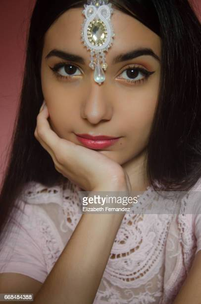 Portrait of young beautiful woman wearing a maang tikka.