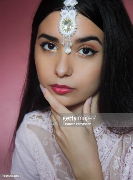 Portrait of young beautiful woman wearing a tikka.