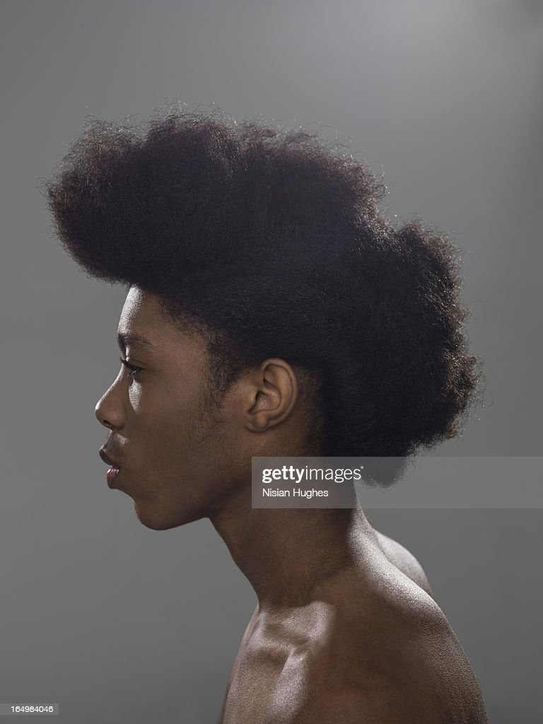 Portrait of young black man with styled big hair : Stock Photo