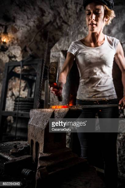Portrait of Young Blacksmith Woman in Blacksmith Shop