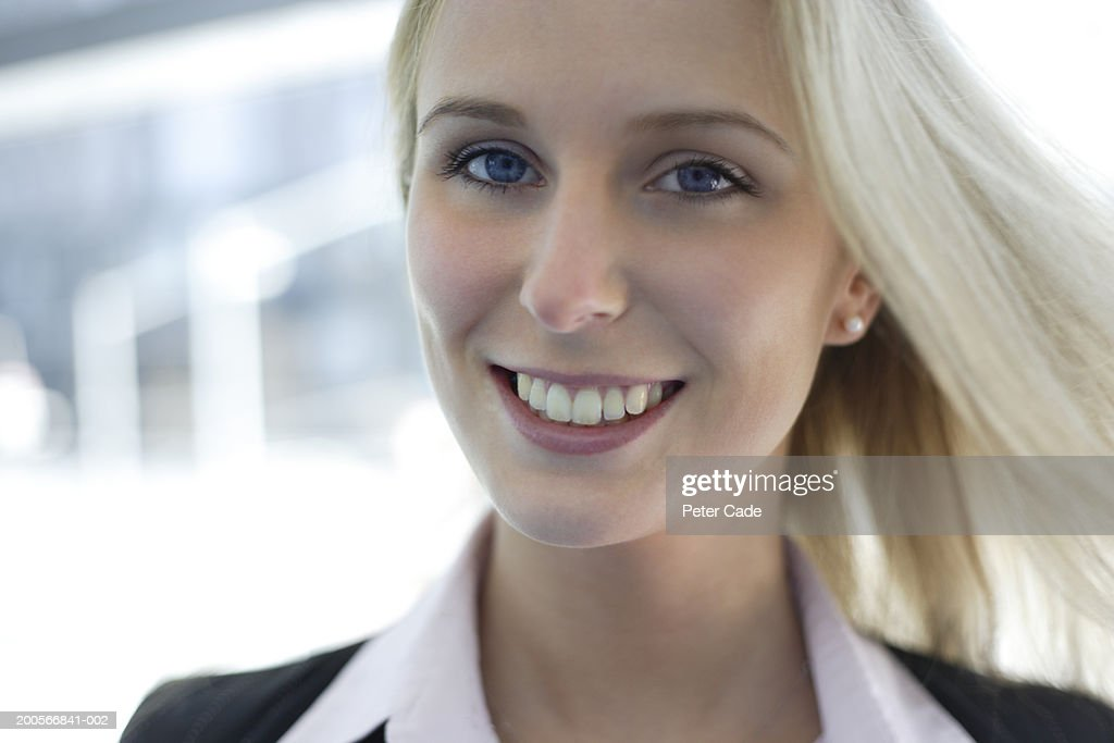 Portrait of young blonde woman smiling, head and shoulders : Stock Photo