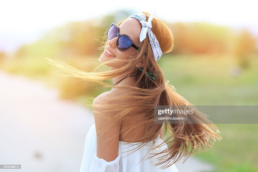Portrait of young boho woman with flowing hair : Stock Photo
