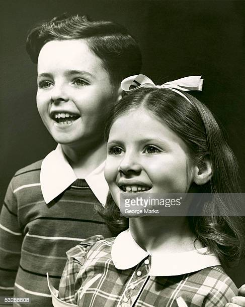 Portrait of young boy and girl