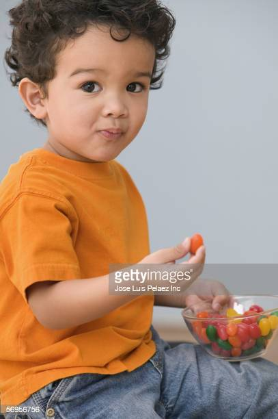 Portrait of young boy eating candy