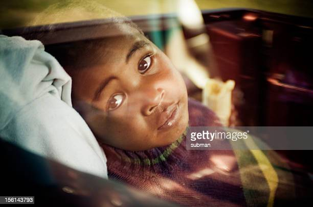 Portrait of young boy in car