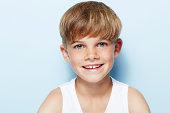 Portrait of young boy in vest, studio