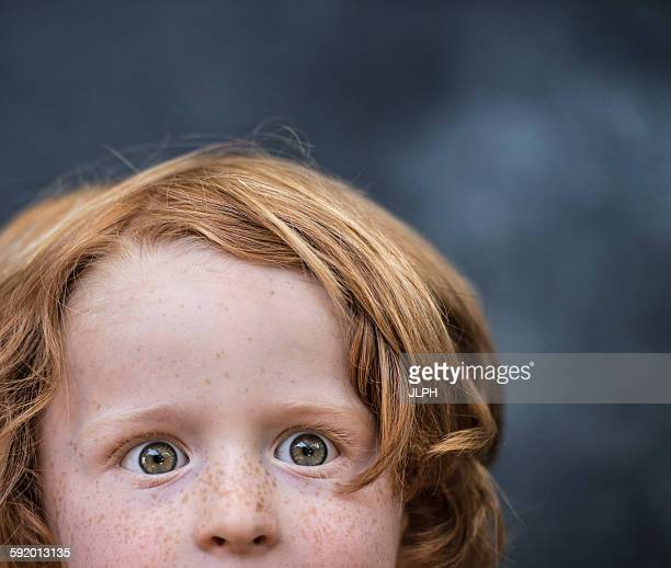 Portrait of young boy, red hair, close-up