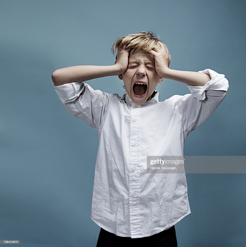 Portrait of young boy screaming