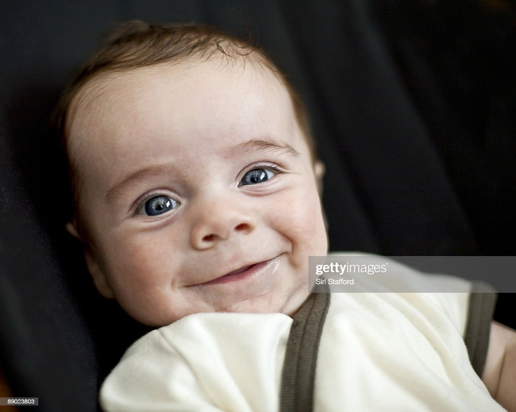 Portrait of young boy smiling : Stock Photo