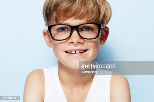 Portrait Of Young Boy Wearing Glasses Studio Stock Photo