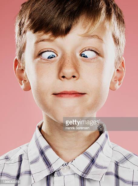 Portrait of young boy with funny face