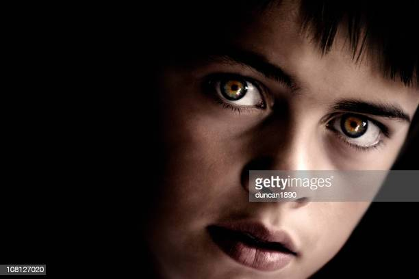 Portrait of Young Boy with Intense Eyes, Low Key