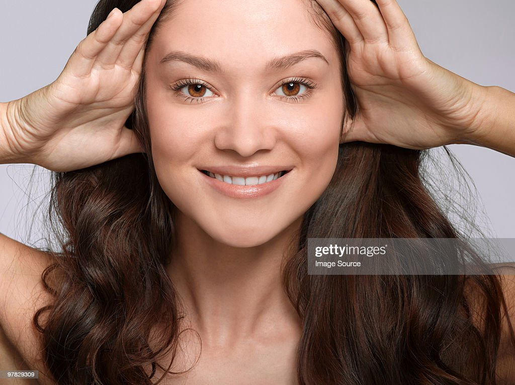 Portrait of young brunette woman : Stock Photo