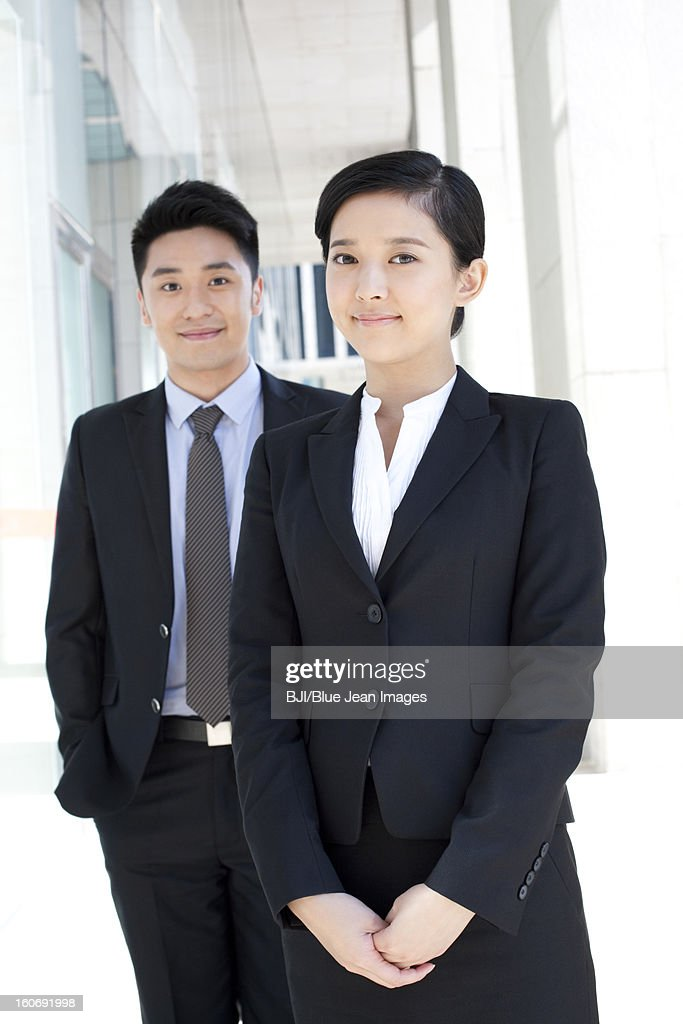 Portrait of young business partners in downtown district : Stock Photo