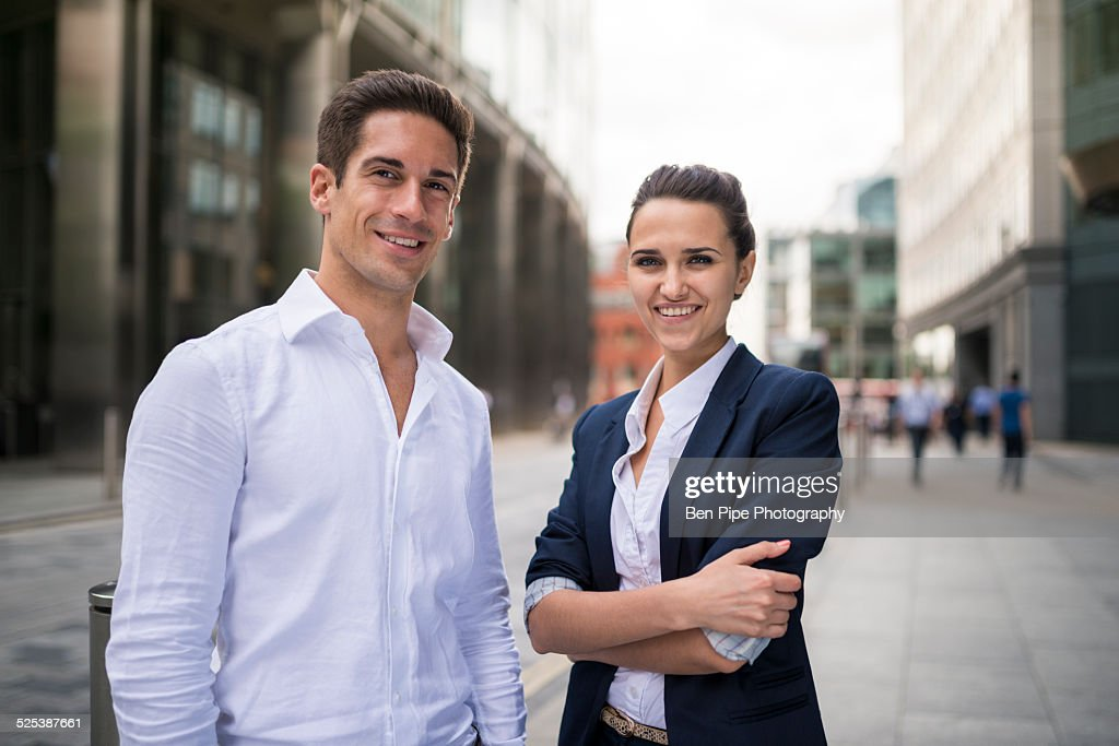 Portrait of young business partners on street, London, UK
